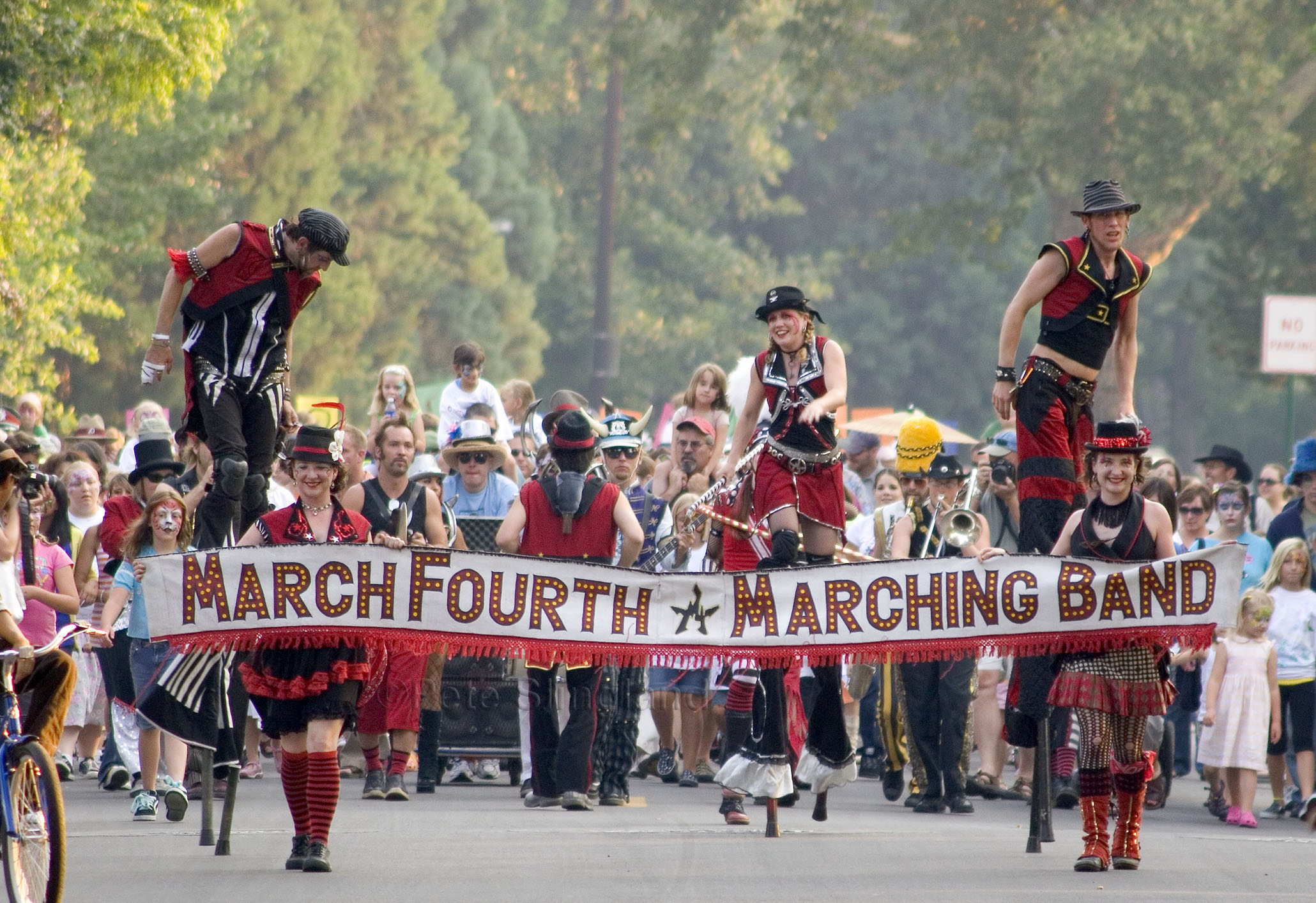 MARCH FOURTH MARCHING BAND:  Bass drummer Dan Stauffer says, Bike more, drive less.